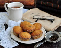 Cup of tea, cakes and ancient books Stock Images