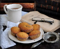 Cup of tea, cakes and ancient books Stock Photo