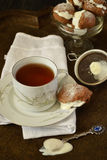 Cup of tea and cakes choux pastry with cream Royalty Free Stock Image