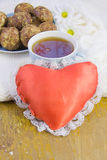 Cup with tea, cakes and  heart Stock Photo