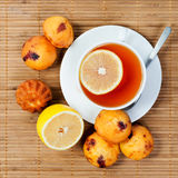 Cup of tea, cakes and lemon Stock Photography