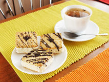 Cup of tea and cakes on the plate Stock Photo