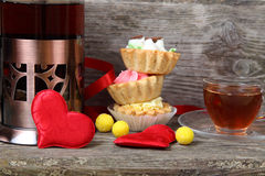 Cup of tea, cakes and red hearts Royalty Free Stock Images