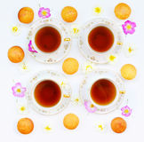 Cup of tea with cakes and roses Stock Photo