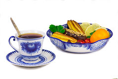 Cup of tea, cakes, sweets, fruit bowl, painted in the style of t Royalty Free Stock Images