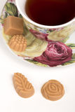 Cup of tea with candies Royalty Free Stock Images
