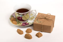 Cup of tea with candies Stock Image