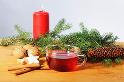 Cup tea with candle and christmas decoration on wooden table Stock Photography