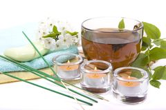 Cup of tea and candles Royalty Free Stock Image