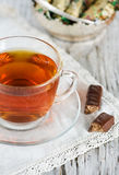 Cup of tea and candy Stock Images