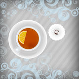 Cup of tea with candy on floral background Royalty Free Stock Photo