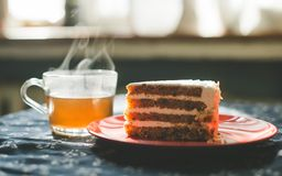 Cup of tea and carrot cake stock photography