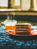 Cup of tea and carrot cake royalty free stock images