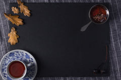 A cup of tea and cedar cone jam Royalty Free Stock Photos