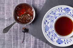 A cup of tea and cedar cone jam Royalty Free Stock Image
