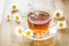 Cup of tea with chamomile Stock Photos