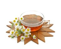 Cup of tea and chamomile isolated on white Stock Photography