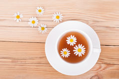 Cup of tea with chamomile. Stock Images
