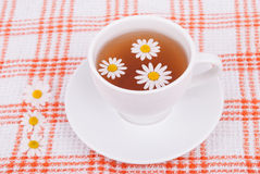 Cup of tea with chamomile. Royalty Free Stock Photos