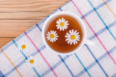 Cup of tea with chamomile. Stock Photo