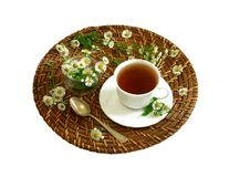 Cup of tea and chamomiles isolated on white Stock Images