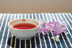 Cup of tea and cherry blossoms with lilac Royalty Free Stock Image