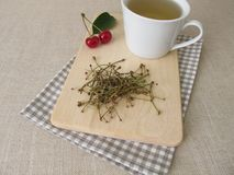 Tea from cherry stems Royalty Free Stock Photo