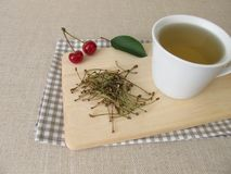 Tea from cherry stems Royalty Free Stock Images