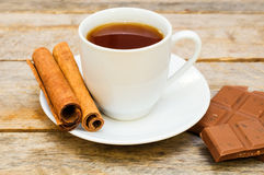 Cup of tea with chocolate and cinnamon Stock Photo