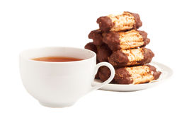 Cup of tea and chocolate cookies. Cup of tea and chocolate dipped meringue cookies on white background Stock Photography