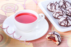 Cup of tea and chocolate decorated iced spice cakes Royalty Free Stock Images