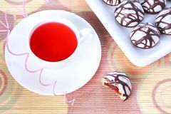 Cup of tea and chocolate decorated spice cakes Stock Image