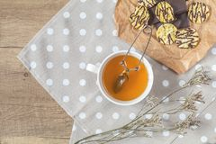 Cup of tea, chocolate, delicious nutritious cereal breads Stock Images