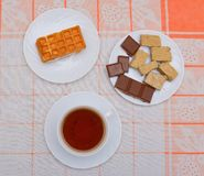 Cup of tea and chocolate with nuts Stock Photos
