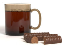 Cup of tea and chocolate sweets Royalty Free Stock Photo