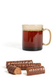 Cup of tea and chocolate sweets Stock Image