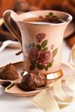 Cup of tea with chocolate truffles Royalty Free Stock Photos