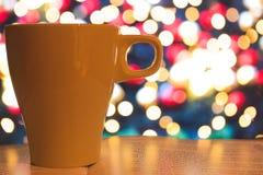Cup of tea. On Christmas bokeh background Stock Image