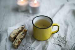 Cup of tea with christmas cookies. Are on the table with lights of candle in winter Royalty Free Stock Photography