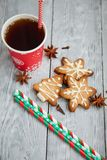 Cup of tea and christmas cookies on the table. Red cup of tea and Christmas cookies on the grey  wooden table Stock Images