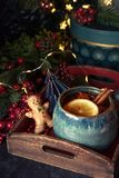 Cup of tea with christmas decoration. Christmas hot tea with lemon and cinnamon at the table with christmas decoration and gifts royalty free stock images