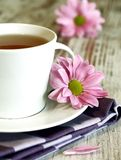 cup of tea and chrysanthemums on old wooden Stock Photography