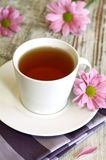 cup of tea and chrysanthemums on old wooden Royalty Free Stock Photo