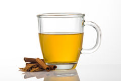 Cup of tea with cinnamon Stock Images