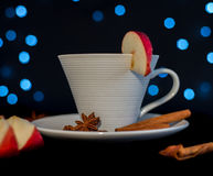 Cup of tea with cinnamon, anise and apple Royalty Free Stock Photos