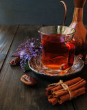 Cup of tea, cinnamon, anise, teapot and flowers Stock Photography