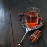 Cup of tea, cinnamon, anise, teapot and flowers Royalty Free Stock Photos