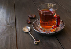 Cup of tea, cinnamon, anise, teapot and flowers Stock Photos