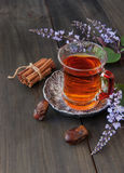 Cup of tea, cinnamon, anise, teapot and flowers Stock Images