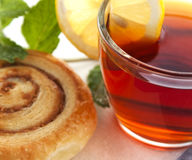 Cup of tea with cinnamon Danish bun Royalty Free Stock Photography